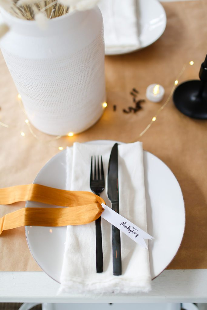 table setting with black cutlery and thanksgiving tags