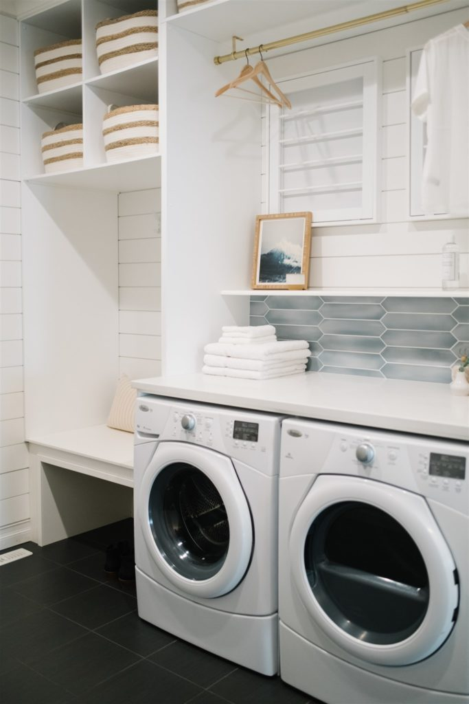 an entryway with washer and dryer