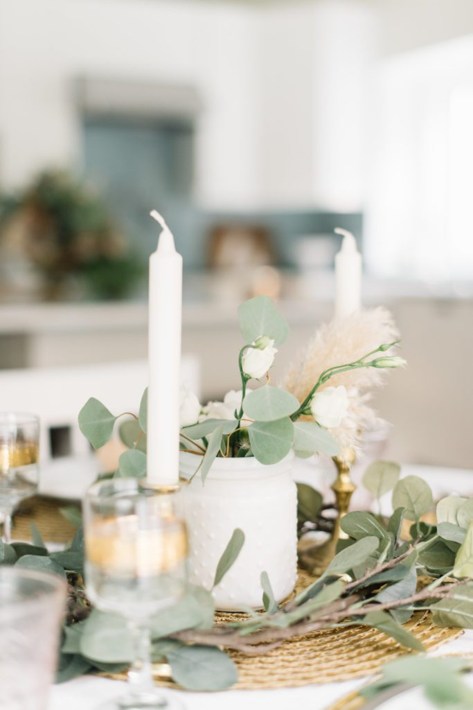 white candles and florals