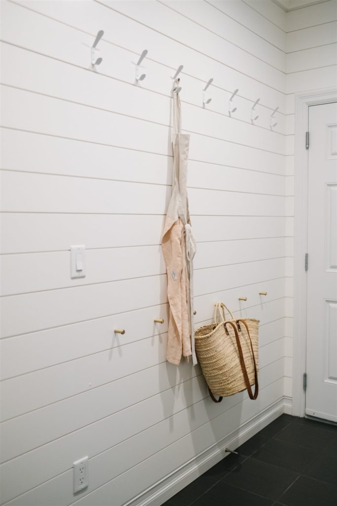 apron hanging on hooks on the wall