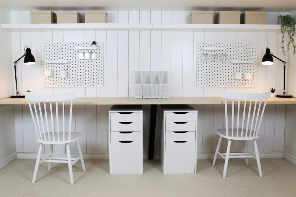 workspace with peg boards, drawers and wooden counters