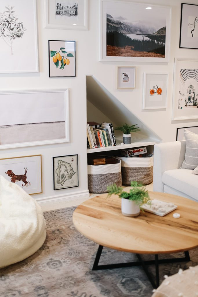under stair storage and a gallery wall