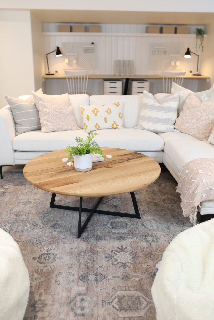 white sectional and wooden coffee table