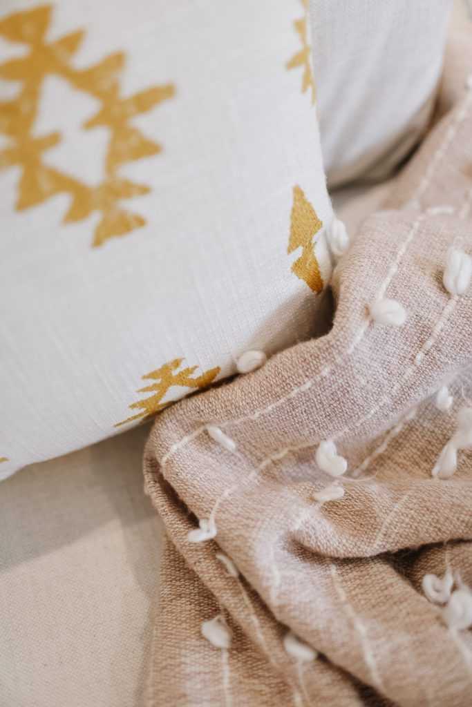 close up of textures on pillows and blanket