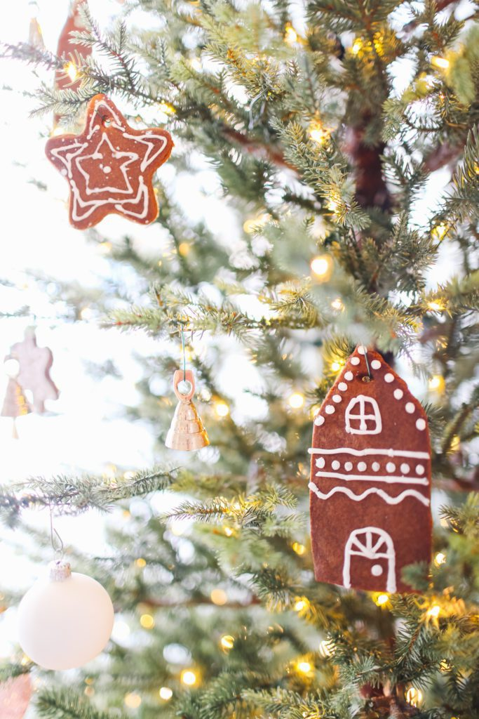Gingerbread cookies hung on a Christmas tree as ornaments
