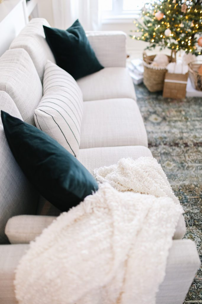 Couch with green throw pillows