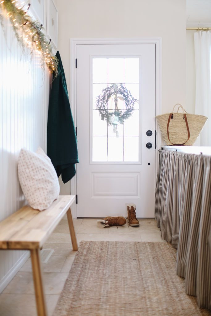 An entryway with ticking strips curtains