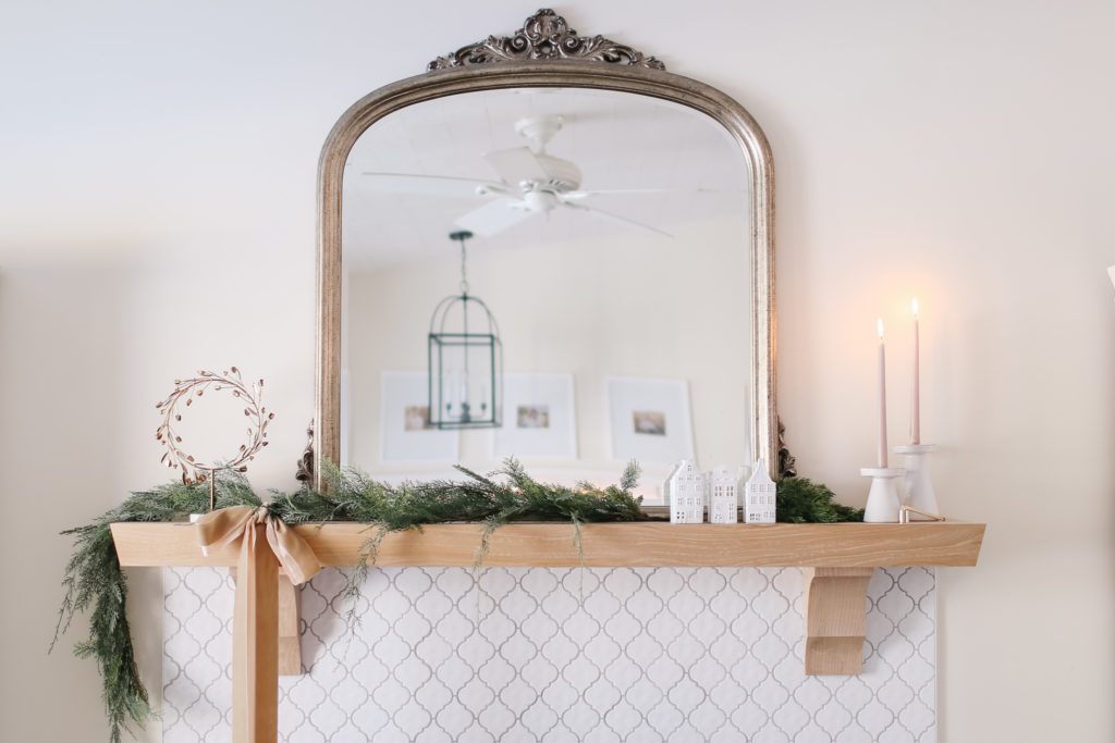 Christmas mantle with large mirror and greens