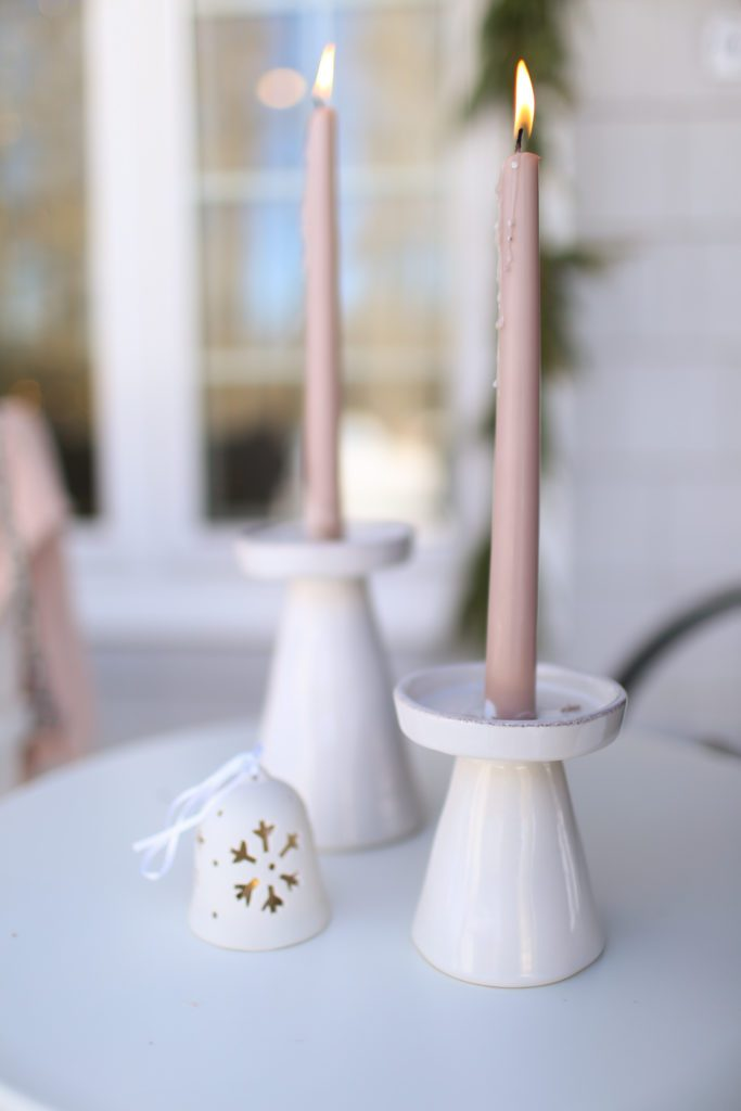 pink candles and white holders