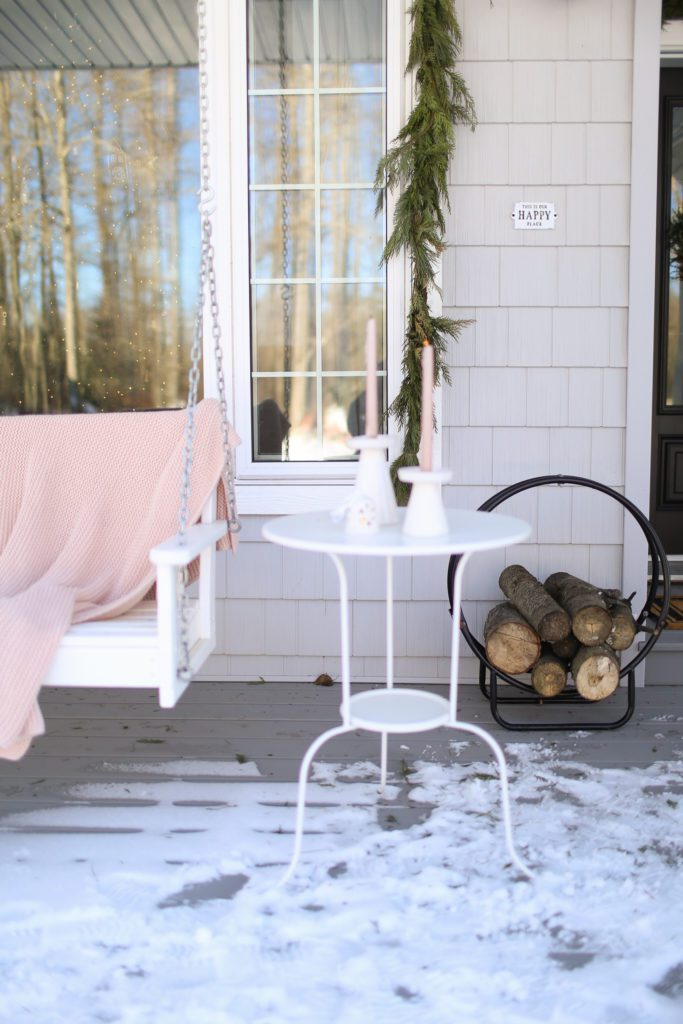 side table on winter front porch