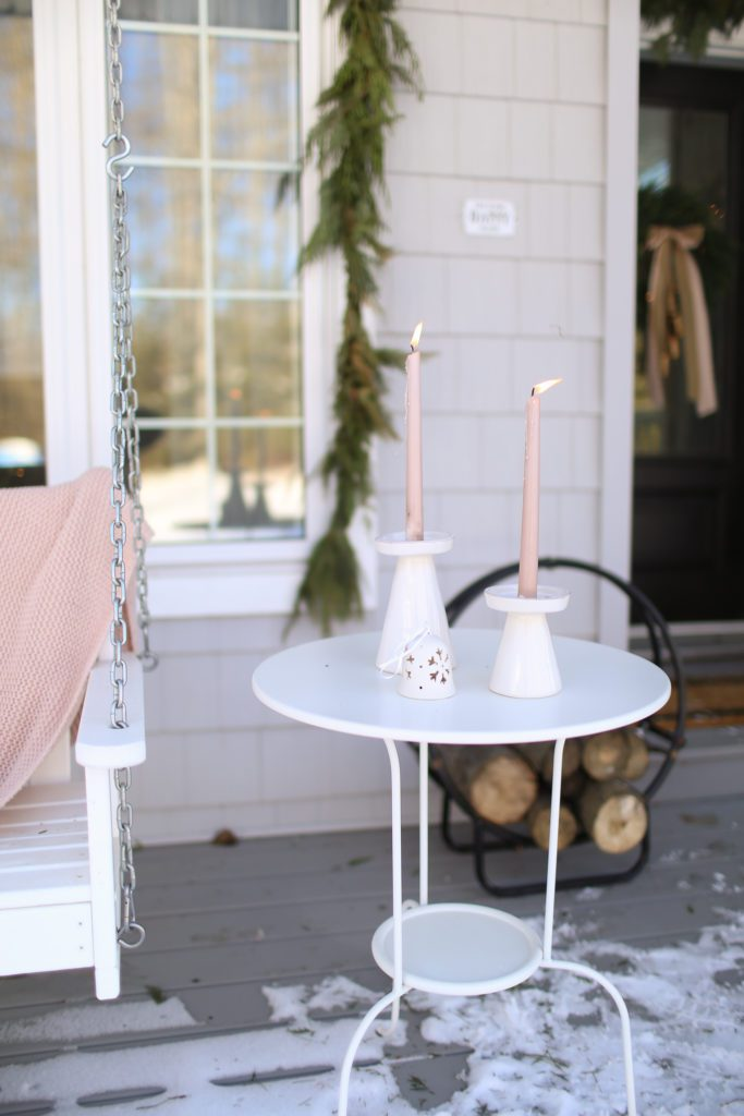 pink candles on an outdoor side table