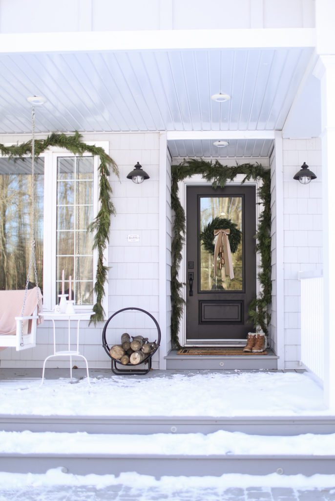 front porch with christmas garland