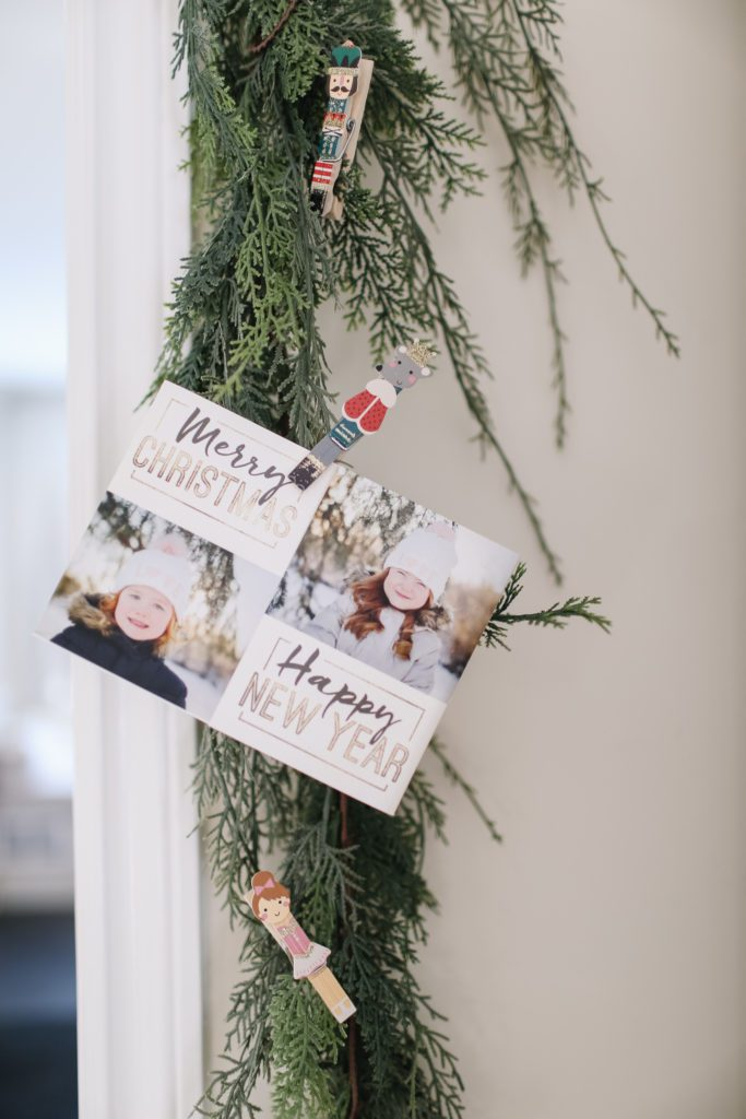 Christmas card attached to garland around a door