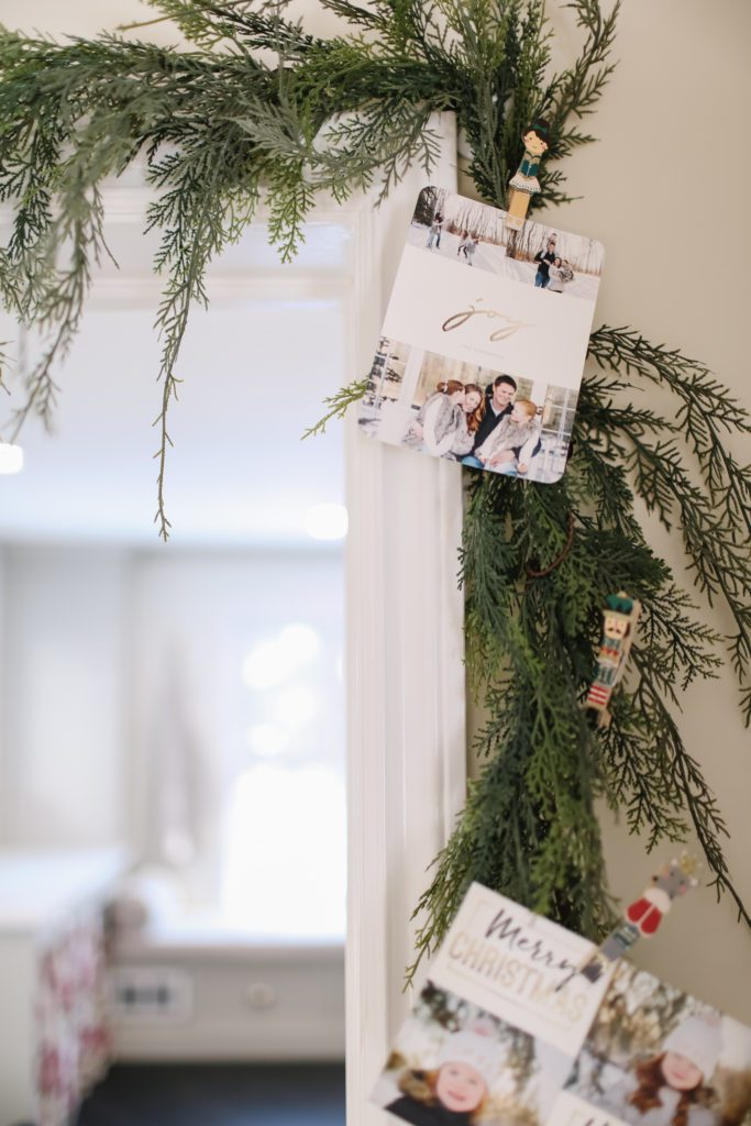 Christmas card pegged on a green garland
