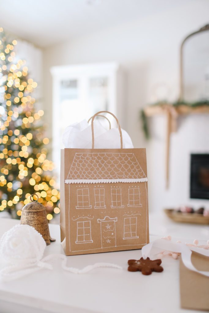 Paper gift bag decorated like a gingerbread house