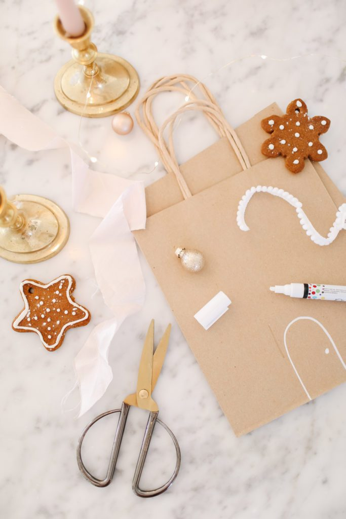 paper bag with ginger cookies ribbon and scissors