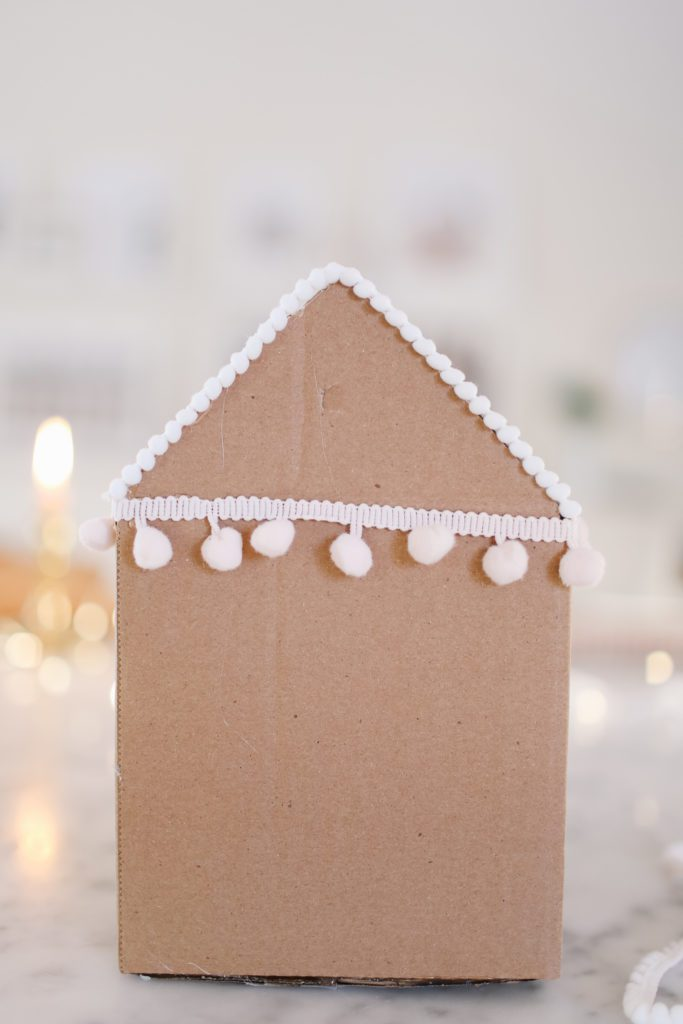 pompom edging on a gingerbread gift box