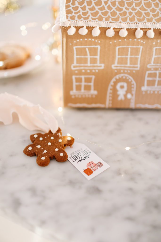 gingerbread gift tag on a marble counter