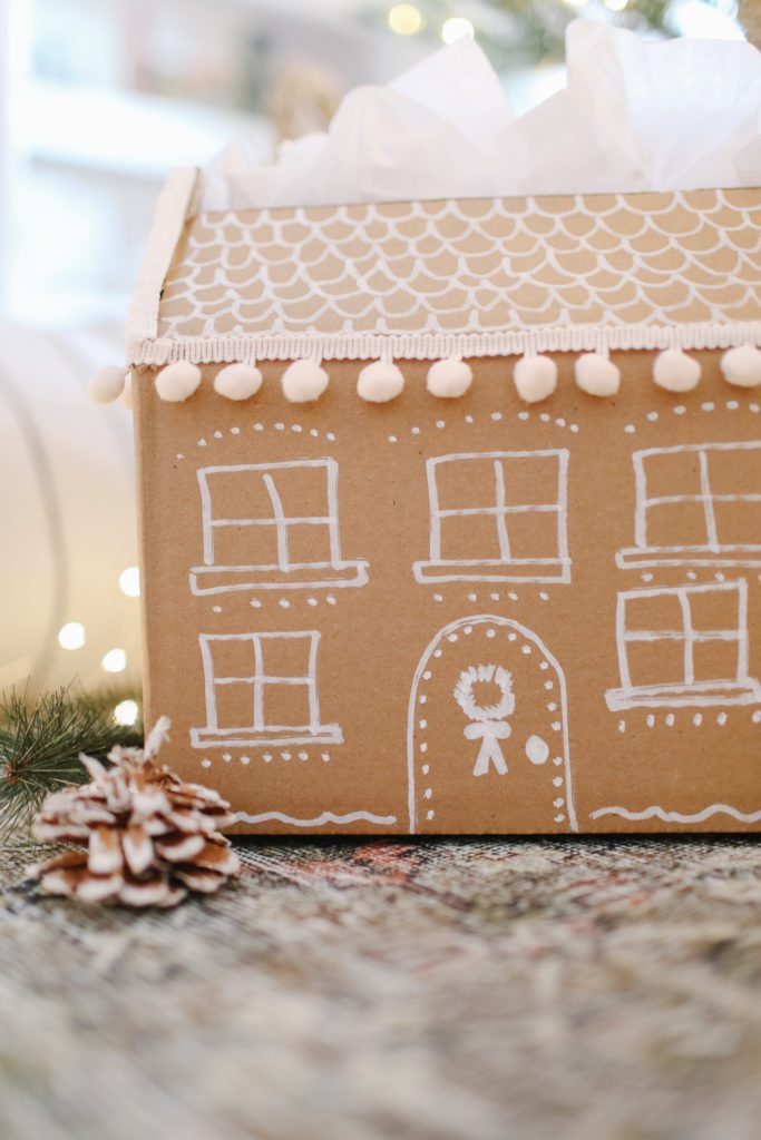 hand made gift box that looks like a gingerbread house
