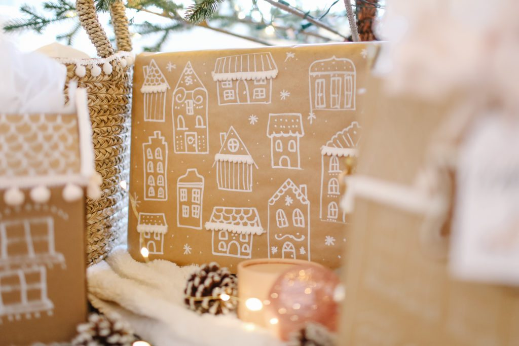 gift wrapped in gingerbread paper under the tree