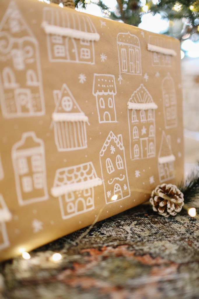 tiny gingerbread houses drawn on brown paper to make gift wrap