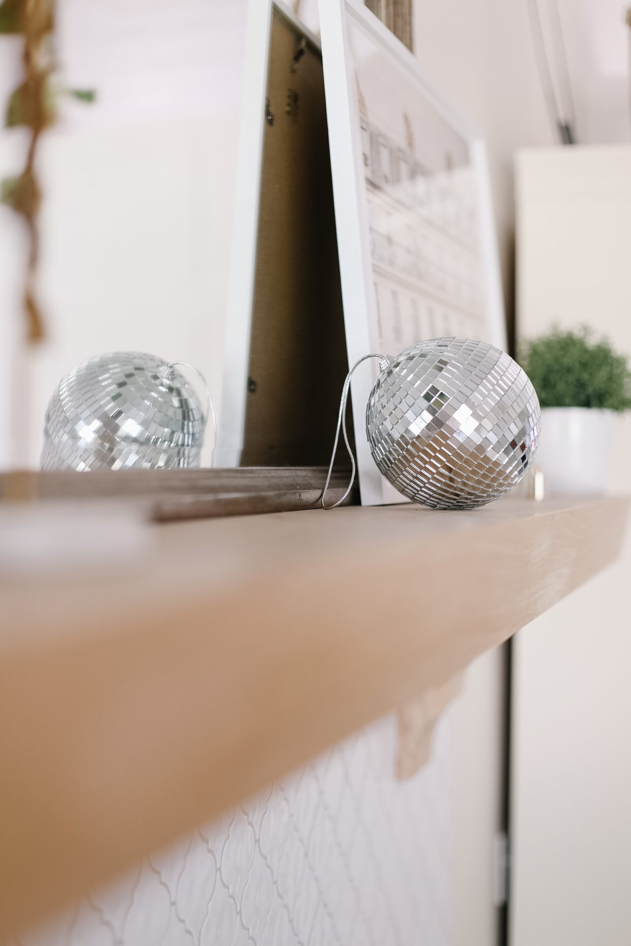 a disco ball sitting on a fireplace mantle