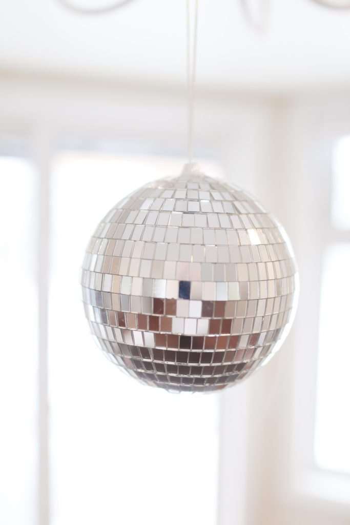 A close up of a hanging disco ball