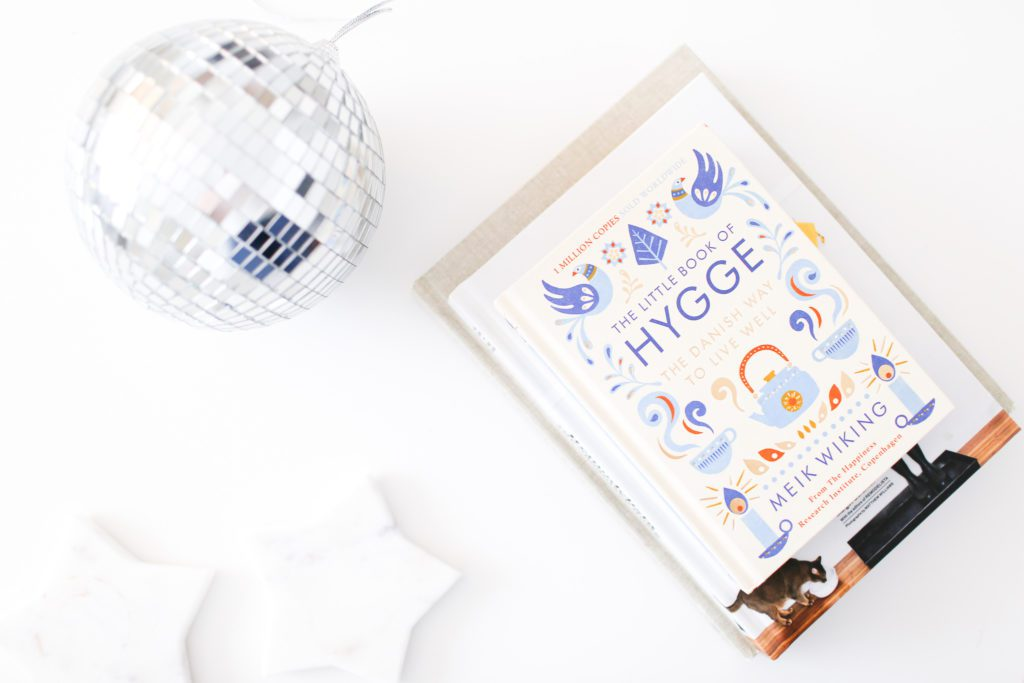 Disco ball and book about Hygge
