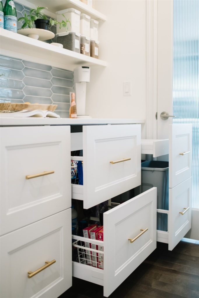open drawers in built in pantry storage space
