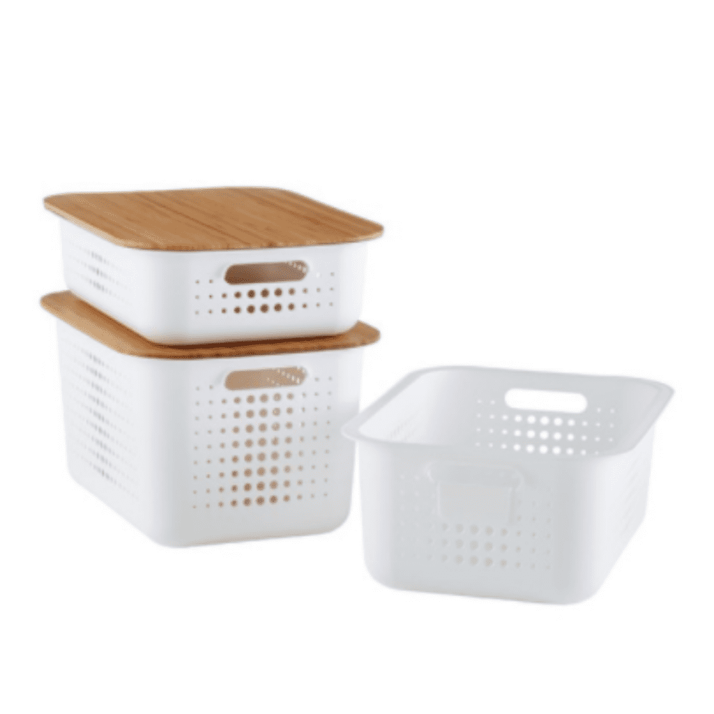 A close up of a white baskets with wooden lids that are great pantry organization essentials