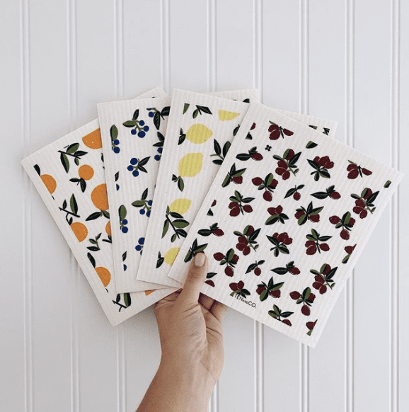 An array of Sponge cloths with orange, blueberry, lemon and cherry patterns