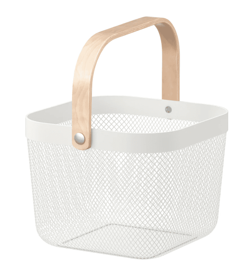 A close up of a white wire basket with pale wood handle