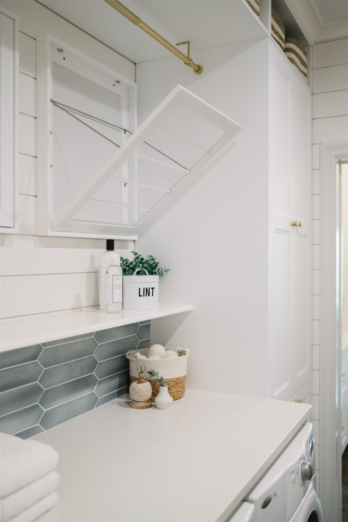 Drying racks above a white counter