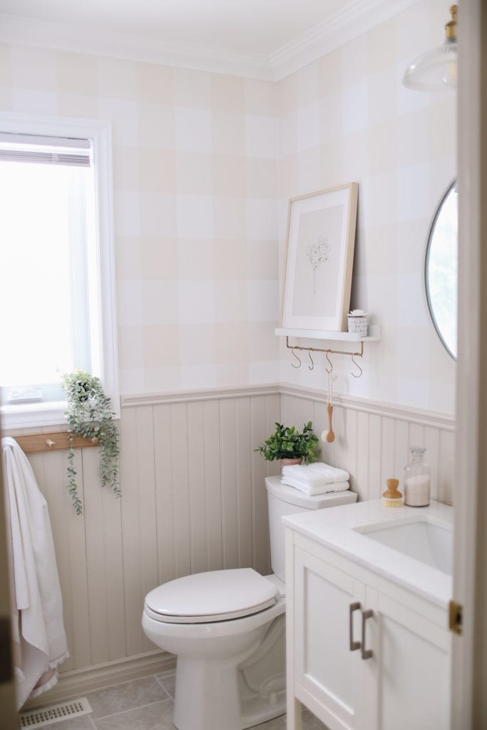 A small bathroom with painted beadboard trim