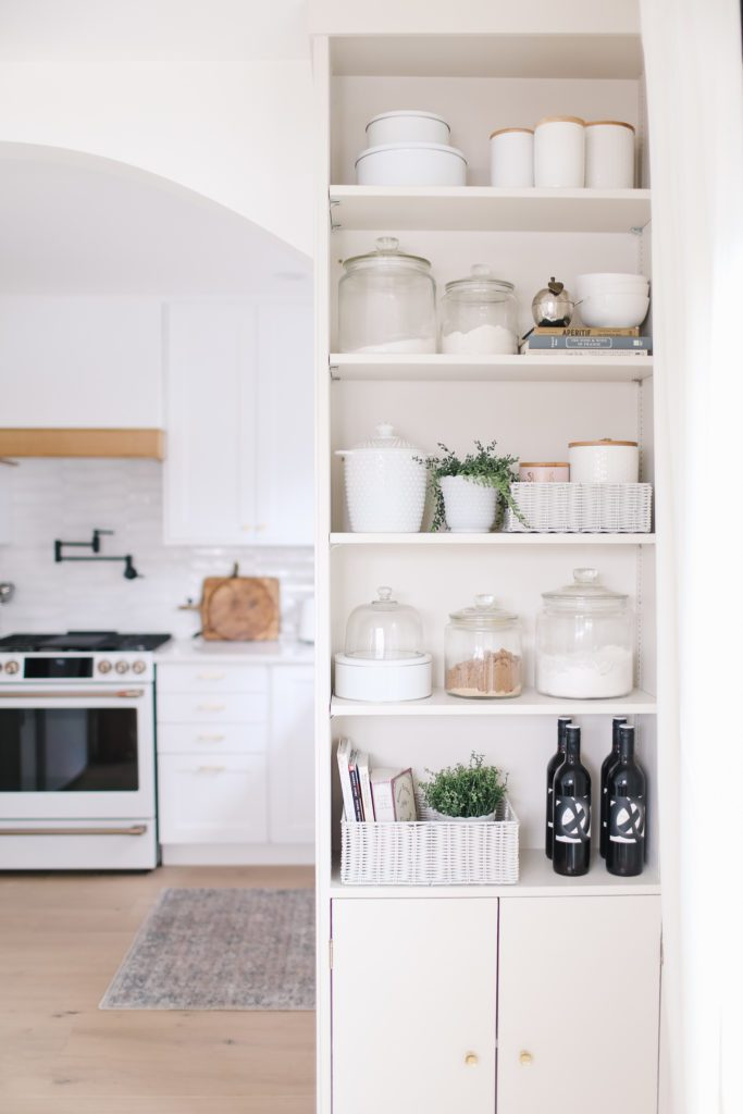 A view of a kitchen shelving