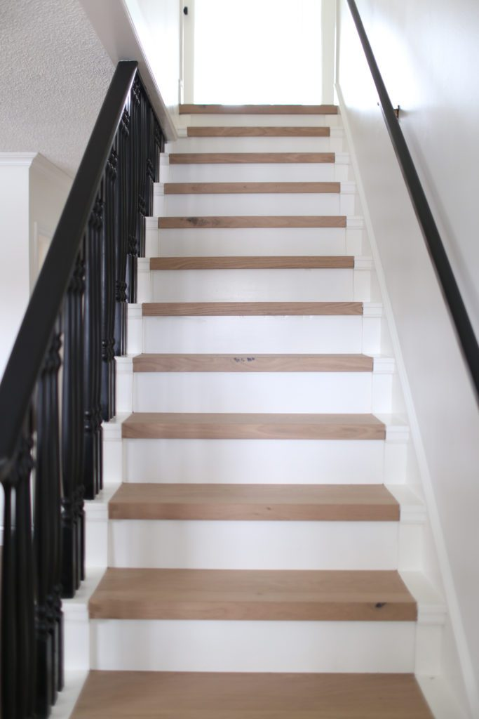 stairs with white oak treads and a black railing