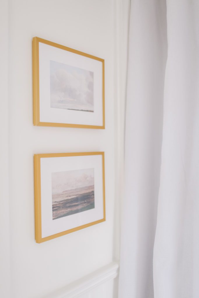 two paintings in gold frames on the wall