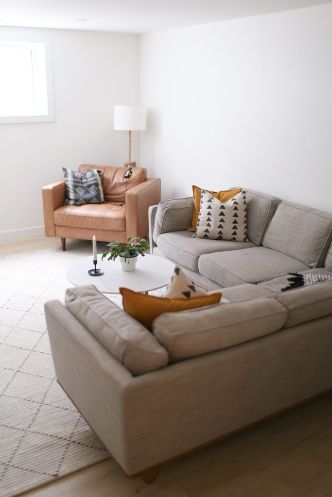 Basement family room with grey sectional