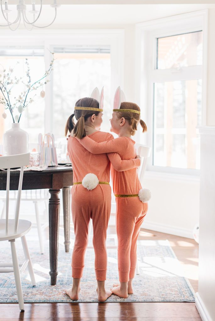 2 little girls with bunny tails and ears