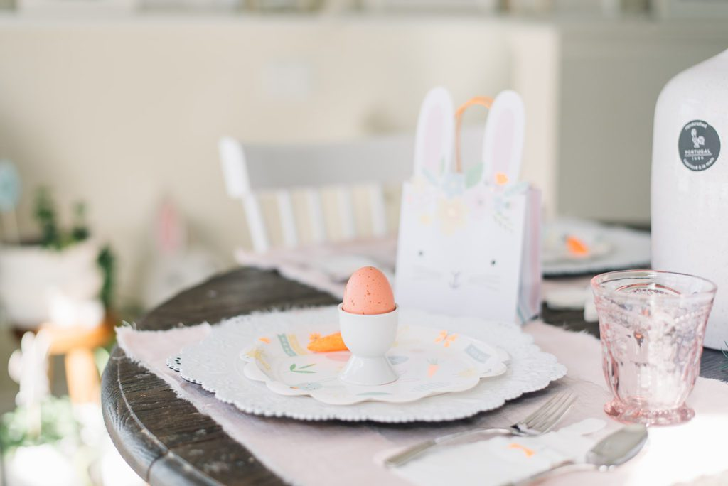 An easter place setting with a bunny gift bag