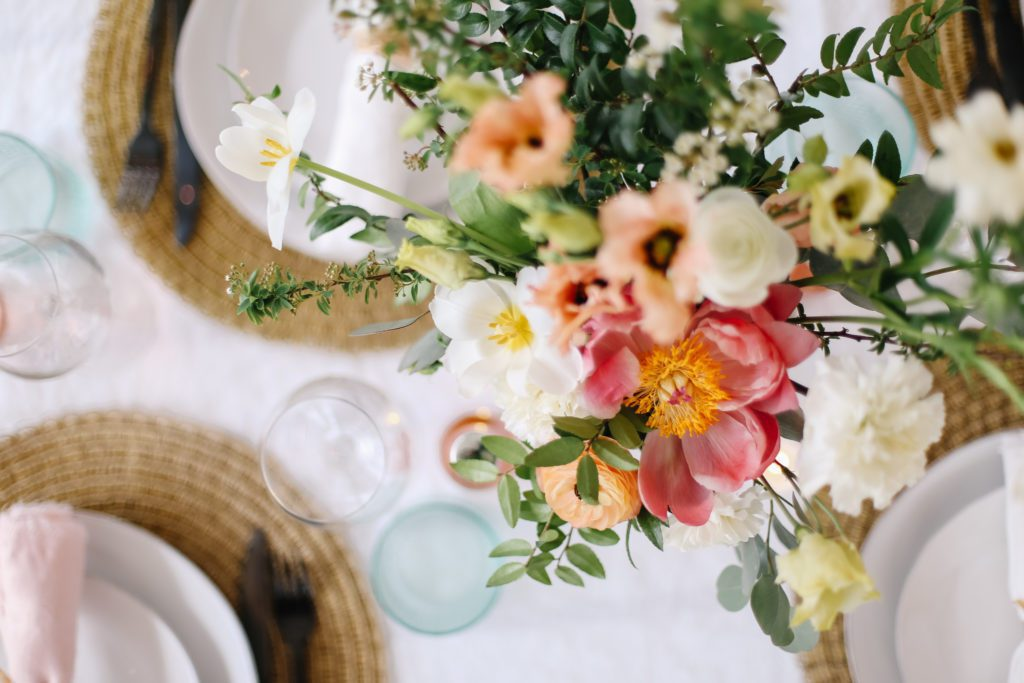 Undone floral arrangement viewed from above on a dining room table