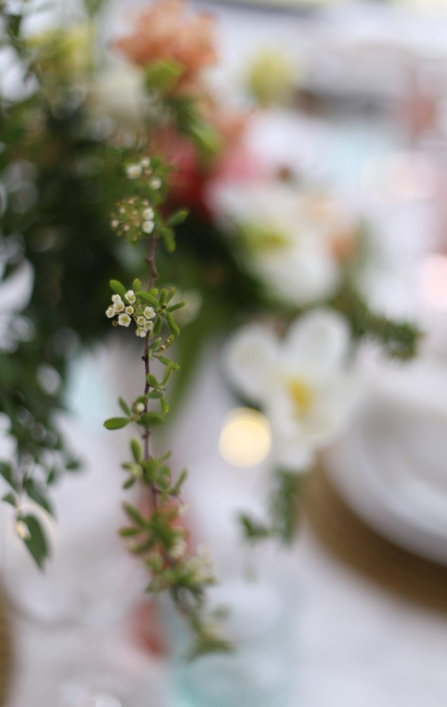 A close up of a dainty greens with tiny white flowers