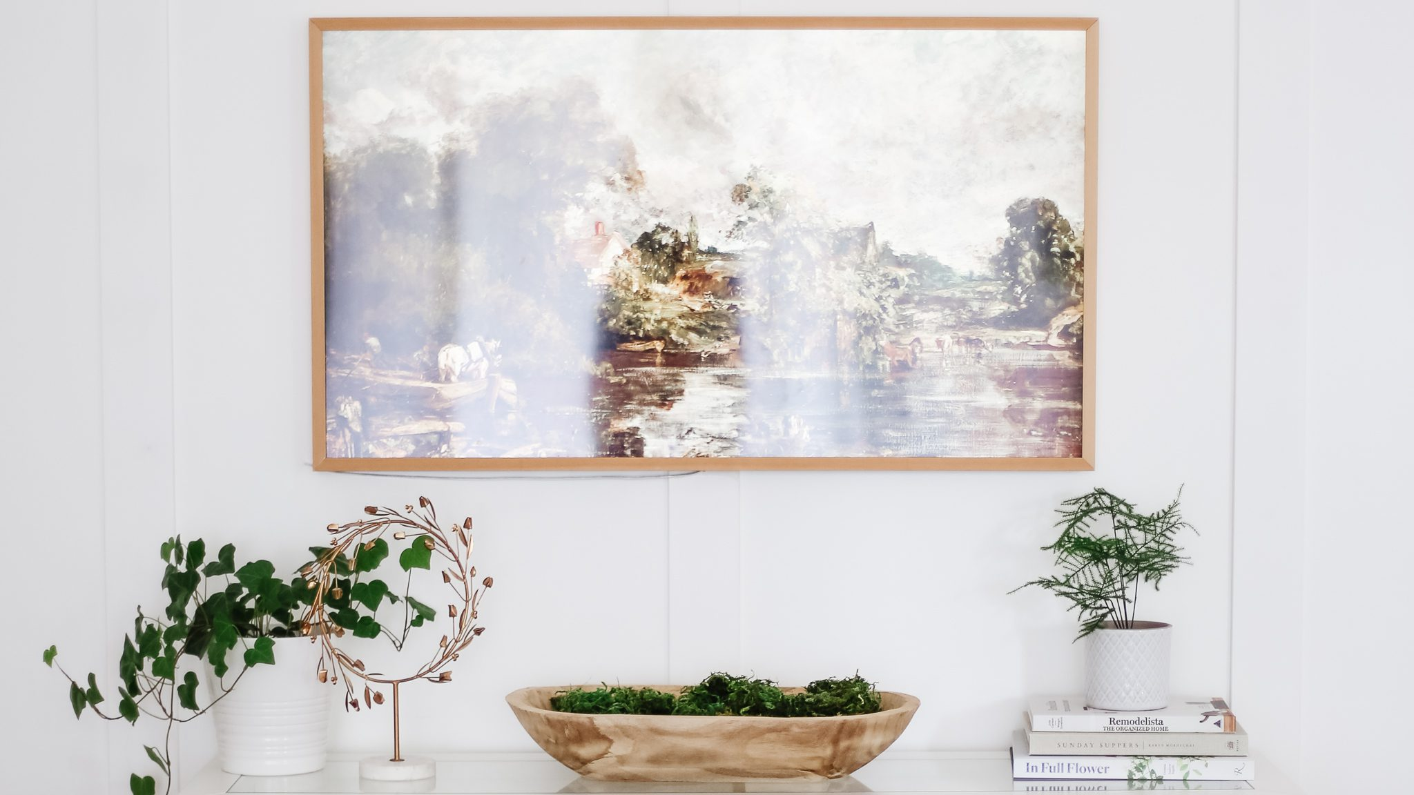 A Samsung Frame TV with framless art loaded of a beautiful vintage painting