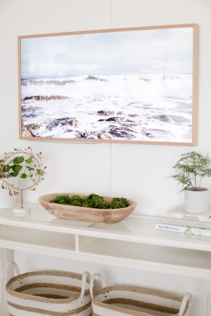 A Samsung Frame TV with a painting of the ocean loaded as art