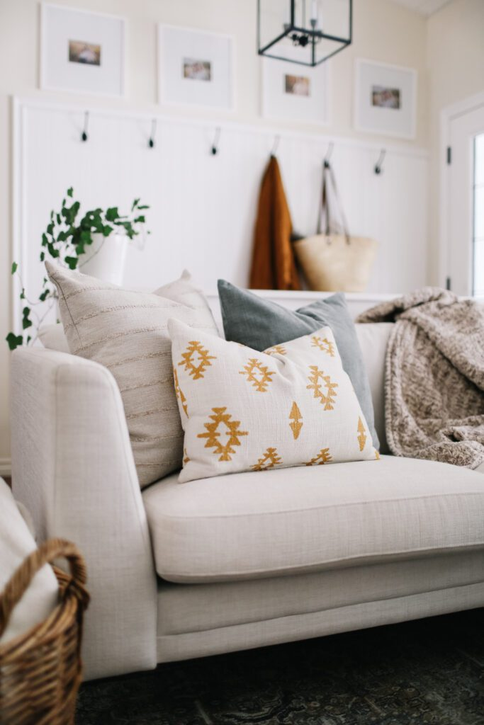 Colorful Throw Pillows and blankets on a couch